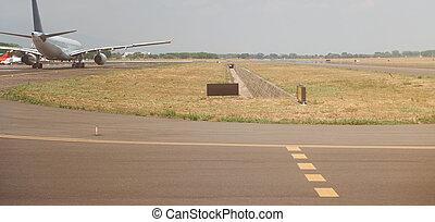 Airplane in airport runway