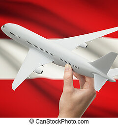 Airplane in hand with flag on background - Austria