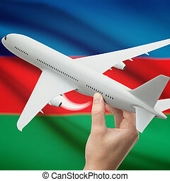 Airplane in hand with flag on background - Azerbaijan