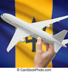 Airplane in hand with flag on background - Barbados