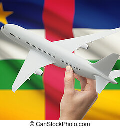 Airplane in hand with flag on background - Central African Republic