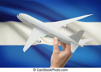 Airplane in hand with flag on background - Nicaragua -...