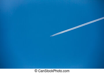 Airplane In Sky With Plane Trails