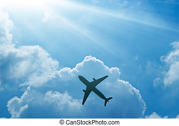 Airplane in the blue sky and cloud at sunrise