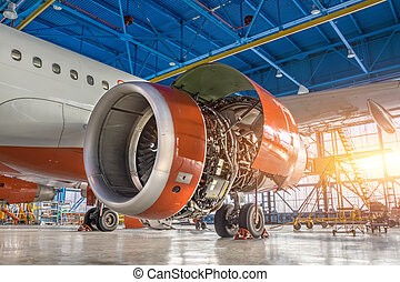 Airplane in the hangar, the engine under repair close-up.