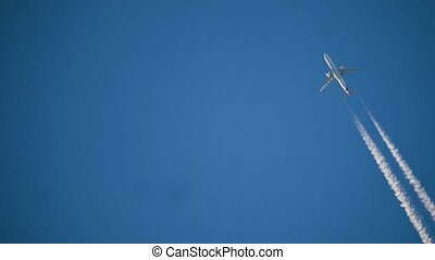 Airplane in the sky at sunrise. the silhouette of an airplane flies in lifestyle the sky a white train