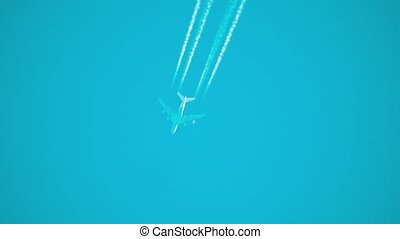 Airplane in the sky at sunrise. the silhouette of an airplane flies in the sky a white lifestyle train