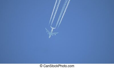 Airplane in the sky at sunrise. the silhouette of an airplane flies in the sky a white train lifestyle