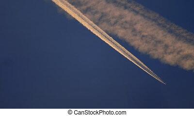 Airplane in the sky, sunset sun reflection - 4K Beautiful...