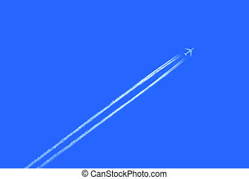 Airplane in the sky with jet trail