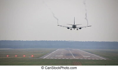 Airplane is Landing at the Airport
