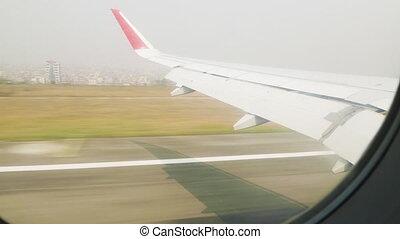 Airplane is landing to the Kathmandu airpot, Nepal.