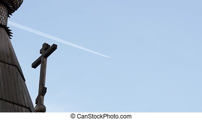 Airplane jet layer, aircraft pollution on sky, on a Christian cross background. 4K