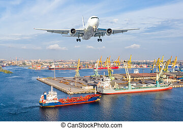 Airplane landing approach over the cargo seaport.