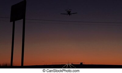 Airplane landing at Airport during sunset
