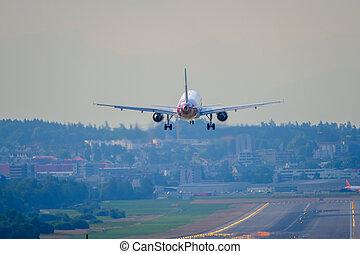 Airplane landing at airport runway