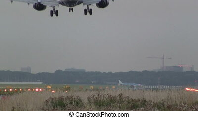 Airplane landing at dusk - This is high quality HD footage...