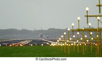 Airplane landing at early morning