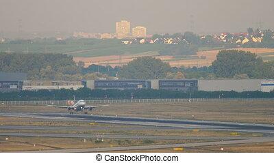 Airplane landing at early morning - Jet airplane landing at...