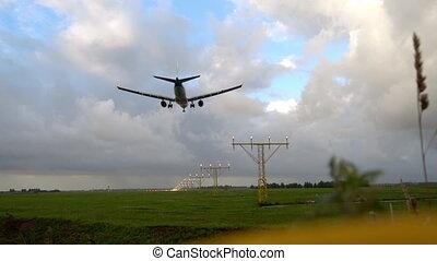 Airplane landing at illuminated runway - Airplane landing on...