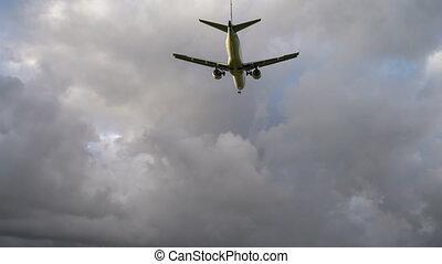 Airplane landing at illuminated runway