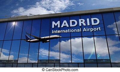 Airplane landing at Madrid mirrored in terminal - Jet...