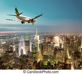 Airplane landing at night in New York City