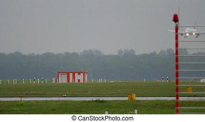 Airplane landing at rainy weather