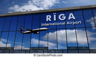 Airplane landing at Riga, Latvia mirrored in terminal - Jet...