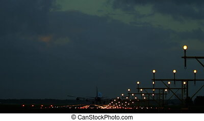Airplane landing at runway 18R - Wide body four-engine...