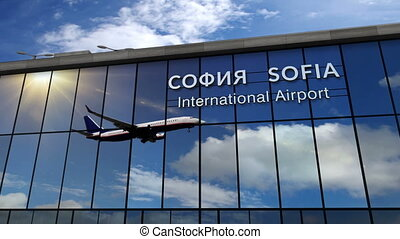 Airplane landing at Sofia mirrored in terminal