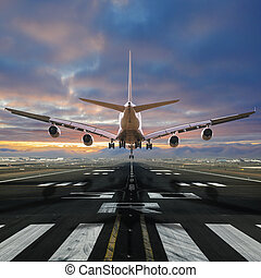 Airplane landing at the airport. - Airplane landing at the...