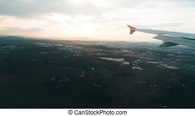 Airplane landing at the airport, view from the window