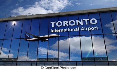 Airplane landing at Toronto mirrored in terminal - Jet...