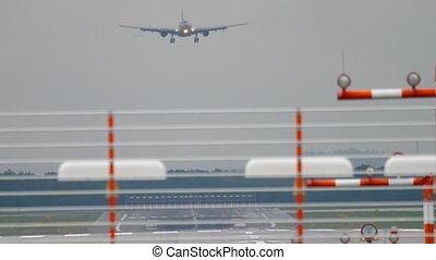 Airplane landing at wet weather