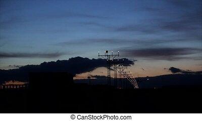 Airplane landing during sunset.