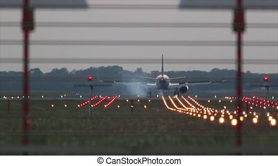 Airplane landing during sunset. - Commercial airplane...