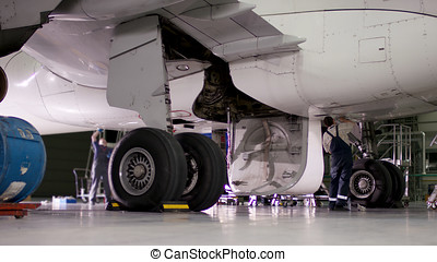 Airplane landing gear wheel. Repair brake of aircraft. Checking aircraft's tire