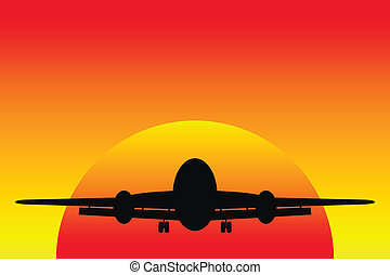 Airplane landing in a sunset