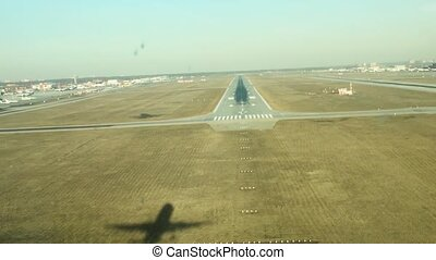 Airplane landing in summer day.Camera on airplane