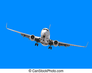 Large commercial airplane flying overhead either after departure or landing isolated on white.