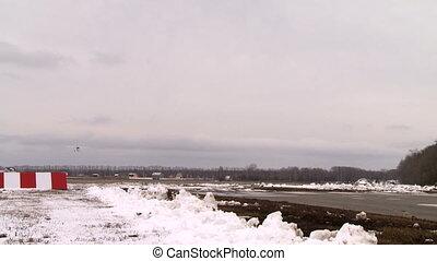 Airplane landing on a runway.