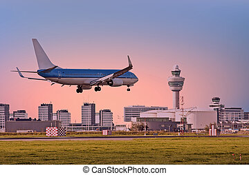 Airplane landing on Schiphol airport in Amsterdam the...