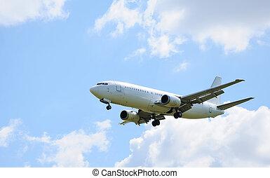 airplane - Landing passenger airliner in blue sky