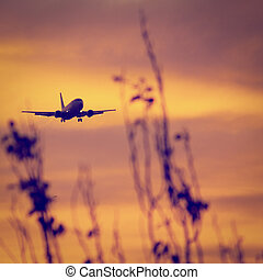 Airplane Landing - Silhouette of a aircraft approaching the...