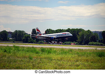 Airplane landing with air-flaps and wheels down Airplane ...