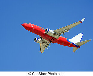 airplane - Large passenger plane flying in the blue sky