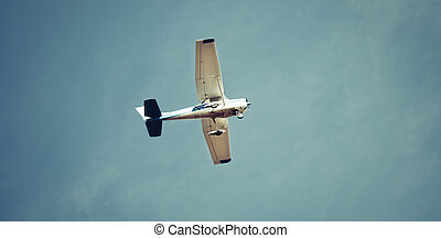 Pilot flying recreational airplane mid air flying in sky