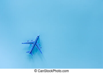 Airplane model on blue background