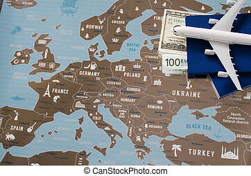 Airplane model, two passports and money. Travel concept on Europe map background.